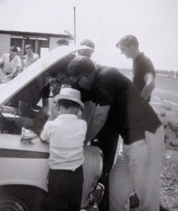 Image of Alan O'Neill, author, as a six year old with a Lotus Cortina race car