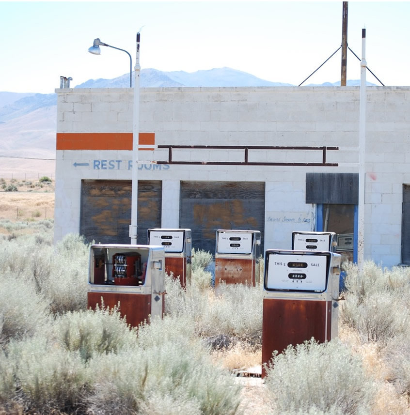 Photo of abandoned gas station with bowsers still showing price of 29 and 9 tenths per gallon. Winnemucca, Nevada