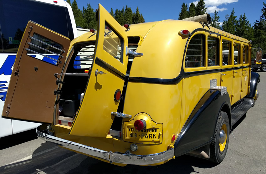 Image of rear cargo door of Yellowstone's classic White bus
