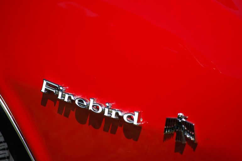 Firebird badge work on the front right fender, classic car from 1967