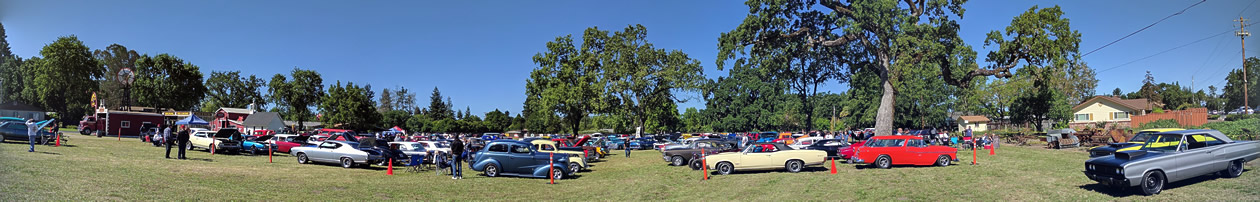 Panorama image of over 200 cars at 2017 Fred Stokes All American Car Show near Windsor, Sonoma Count California