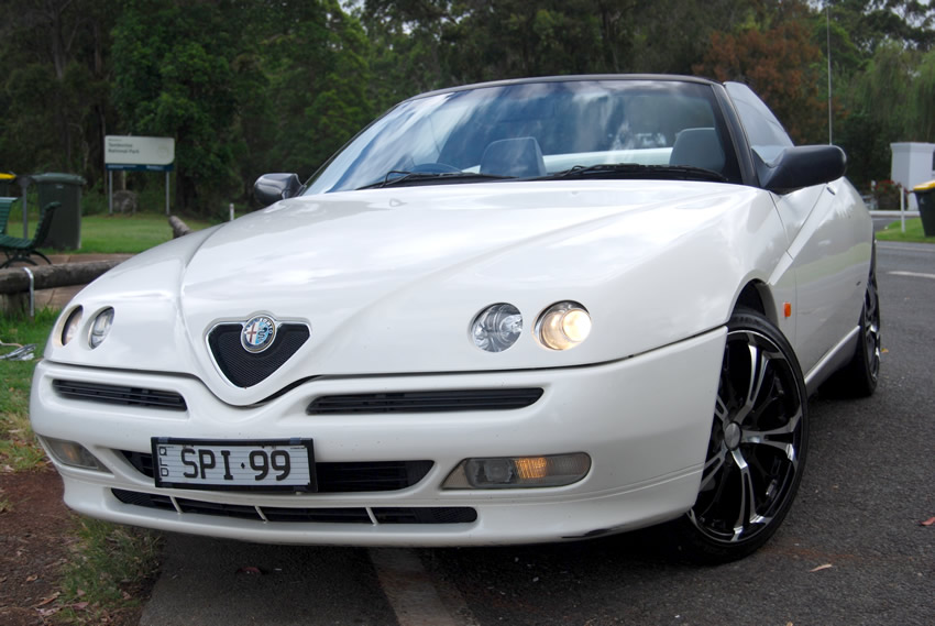 Registered license plate SPI99 - Alfa Romeo Spider 916 model from 1999 at Tamborine Mountain Rotary Lookout, Qld Australia