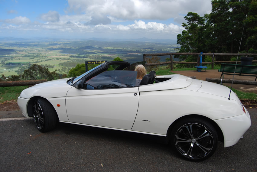 Image of Carolyn in her Alfa Romeo 1999 year model Spider special Millennium Edition with the roof down