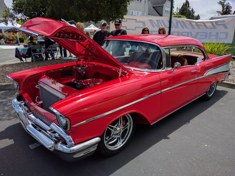 Front left quarter view of the red 57 Chevrolet Belair customized car.