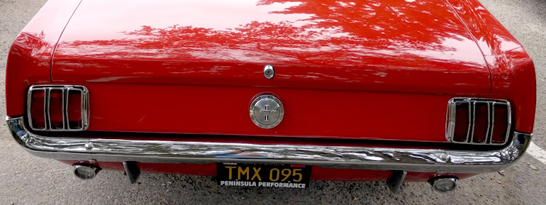Image of red Mustang convertible with original rear tail lights and indicators