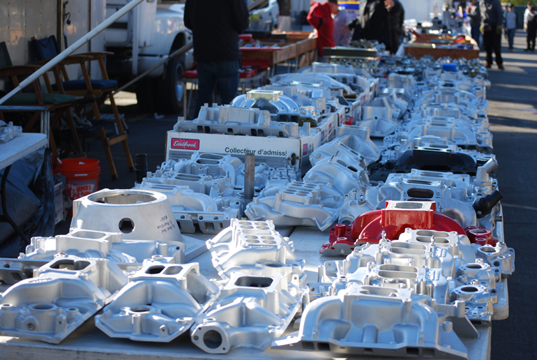 Edelbrock intake manifolds extend far along the swapmeet alley at Alameda Fairgrounds, Pleasanton, Ca.