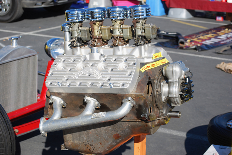 Sidevalve or flathead V8 at the swapmeet, fully restored and with 4 carburettors and new Edelbrock aluminum alloy heads.