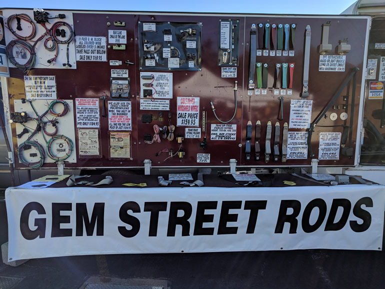 Gem Street Rods display board at a swap meet in Alameda Fairgrounds for wiring harnesses and engine accessories