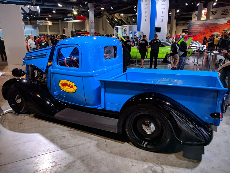 Side view of the blue 37 Dodge pickup with a Mopar crate engine