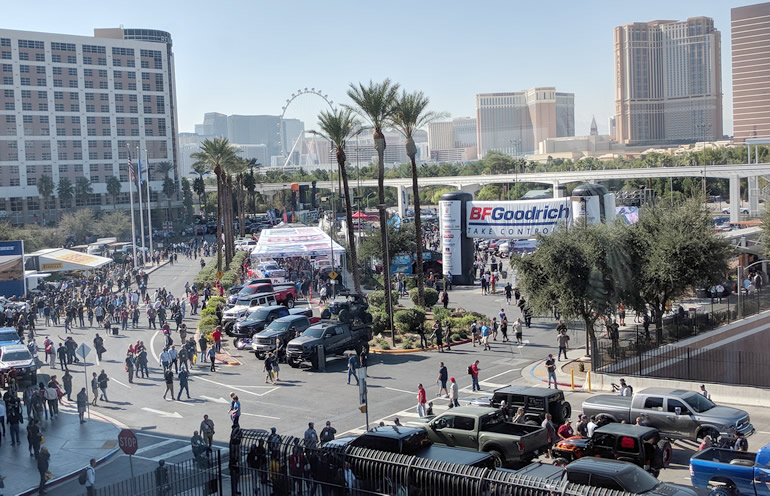 Las Vegas skyline and date palms backdrop the SEMA Show main gate