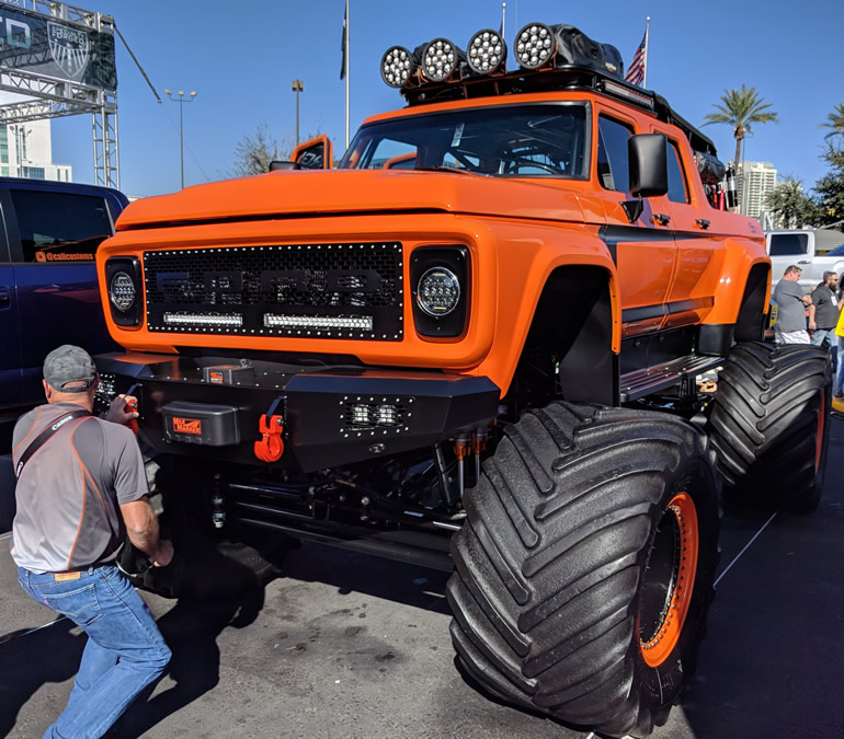 F Series Ford resto mod displaying huge tractor tires and offroad accessories