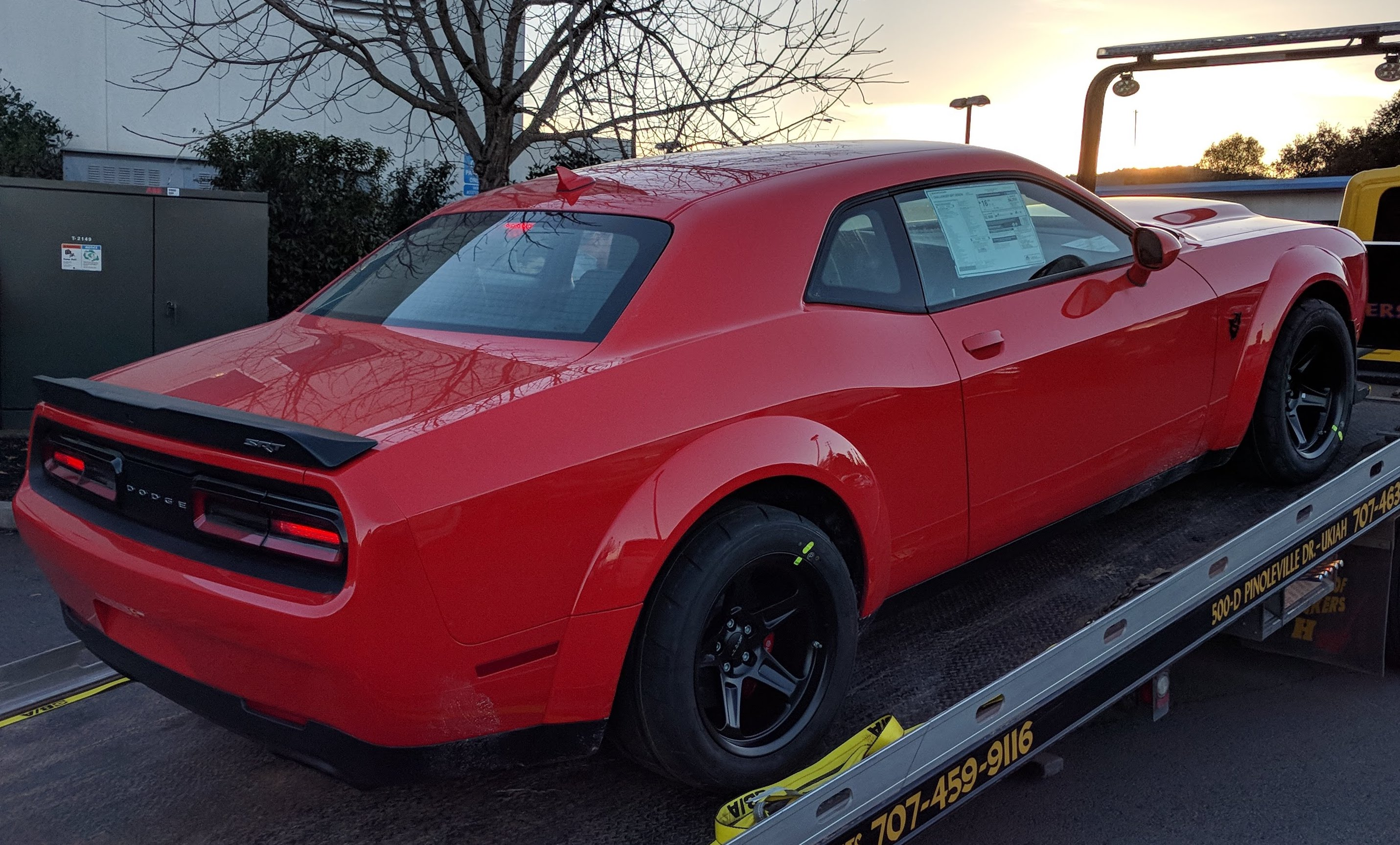 New Dodge SRT Challenger Demon rolling of the delivery truck. Straight from the factory.