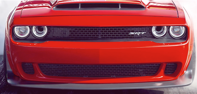Dodge Challenger SRT Demon head on showing image of air intakes in the middle of the driving lights