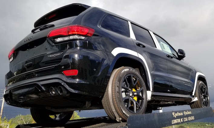 Ominous against the stormy skies in northern California. Jeep Cherokee Supercharged Blackhawk storms into the dealership.