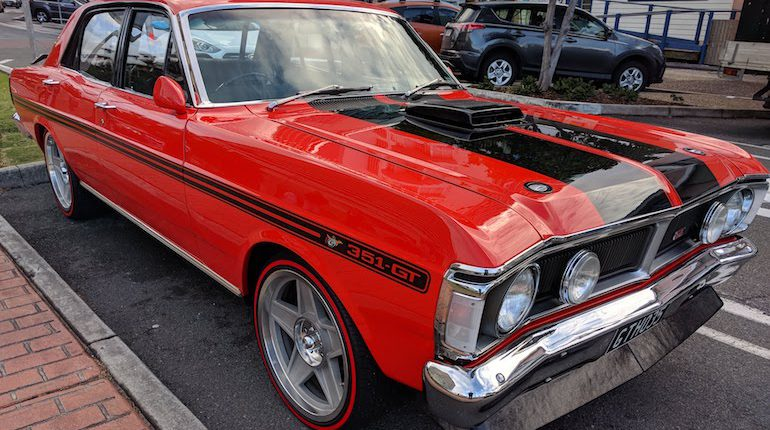 Ford Falcon 351 GT-HO in vermillion fire with modern low profile tires