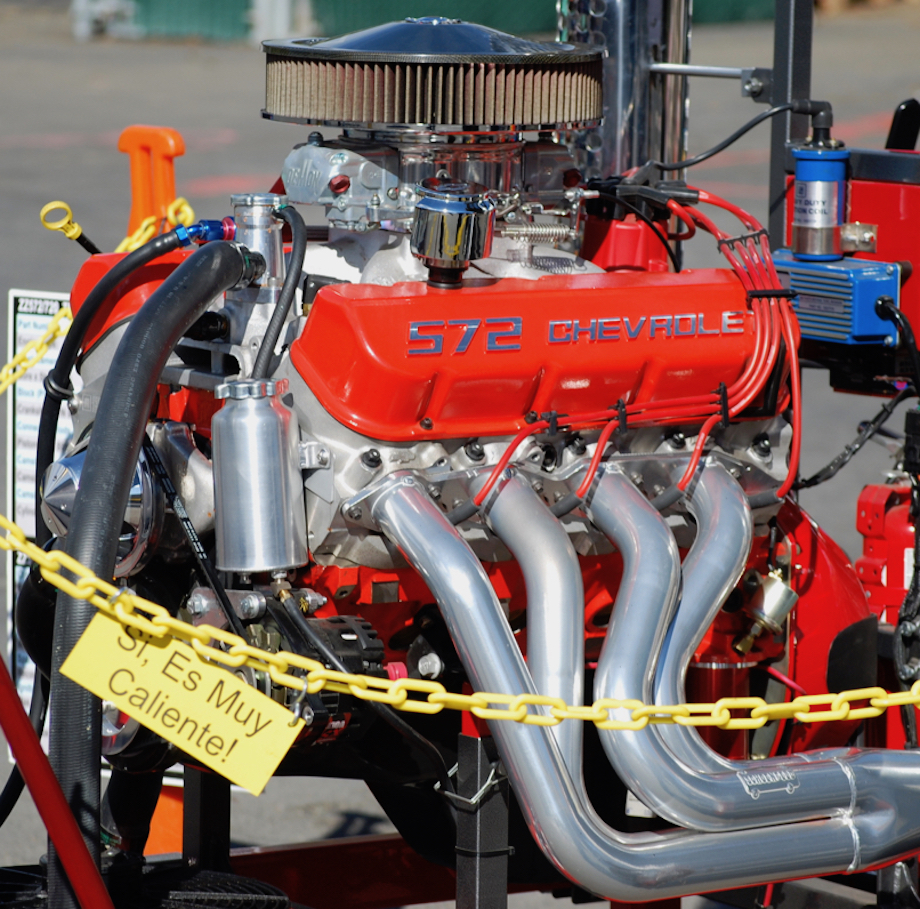 572 Chev crate engine mounted to a testing frame for demonstration at a Goodguys car show in Pleasanton
