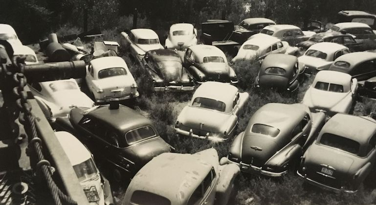 1960s photo of the wrecking yard with classic cars corralled