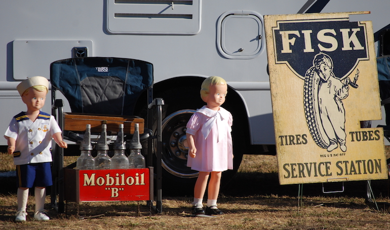Time to Retire Fisk Tires sign with oil bottle display at Stokes Ranch petroliana swap meet